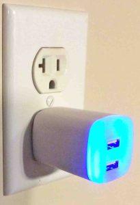 Picture of the GE Jasco Y14 2.1 amp USB charger adapter, plugged in, showing the built in LED night light. JBL Flip 2 charger replacement.