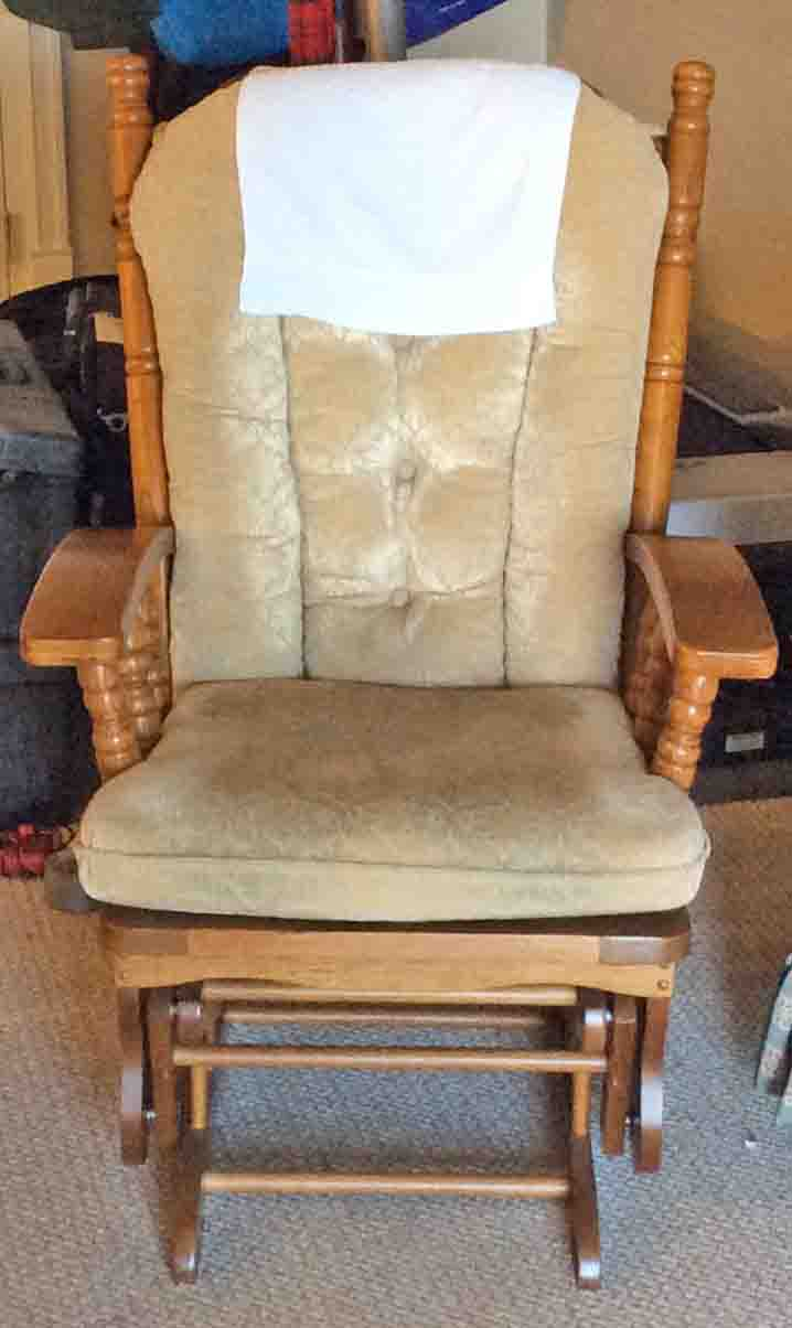 Picture Of A Typical Wooden Glider Rocker With Cushions Well Used