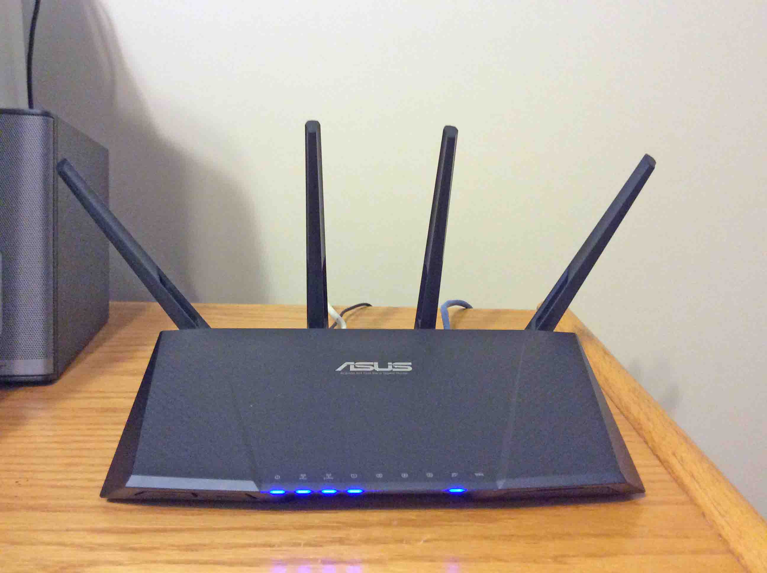 Boost wifi reliability with the asus rt ac87r router toms tek stop picture of the asus rt ac87r wireless router front view installed and operating keyboard keysfo Image collections