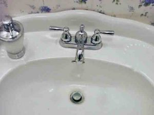 Picture of our bathroom sink, with the broken faucet replaced.