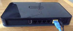 Picture of the rear view of the Netgear WNDR4300 N750 Wi-Fi Router, showing the USB, Internet Ethernet, and power ports as well as the power switch.