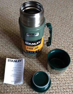 Picture of a disassembled 24 ounce Stanley Classic Vacuum Food Jar, that shows all included attachments.