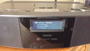 Picture of the Denon S-32 Network Radio Player, displaying the Wireless Setup-Connecting-Wait-Initialize screen.