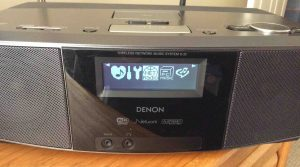 Picture of the Denon S-32 Radio, displaying the Source Selection menu screen. The I-Net Radio item is selected, in reverse image.