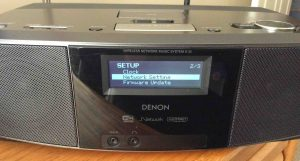 Picture of the Denon S-32 Receiver, displaying the -Network Setting- menu item selected.
