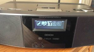Picture of the Denon S-32 Wi-Fi Player, displaying the Settings menu item selected.
