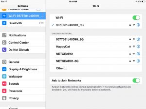 Picture of the iOS Wi-Fi Network Connections Screen, showing a list of available in-range, and connected Wi-Fi networks.