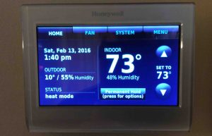 Reset Honeywell thermostat settings: Picture of the Honeywell RTH9580WF WiFi Smart Thermostat, showing the Home screen.