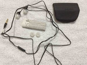 Picture of the Koss KEB30K Noise Isolating Earbuds, unpacked view, showing the earphones, ear tips, instructions, storage case, and instructions.