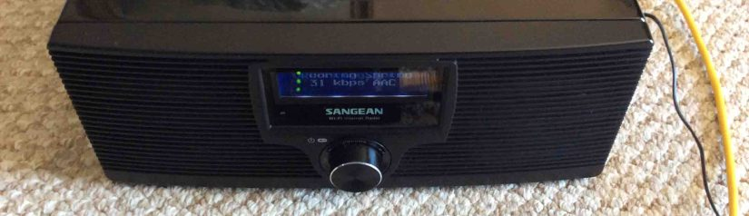 Picture of the Netgear WNCE2001 Universal Internet Adapter in action, feeding the Sangean WFR-20 Internet radio via its wired connection.