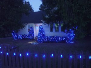 Picture of Blue LED Xmas Lights Outdoors, our home picket fence with C9 LED lamps decorating it.
