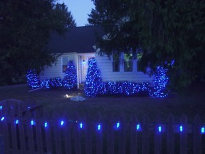 Picture of light decorations outdoors, our home picket fence with C9 LED lamps decorating it.