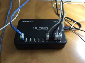 Picture of the Gearmo® 10-Port Smart USB Charger, ICS-10P-HO, operating, with some cords connected. JBL Flip 2 charger replacement.