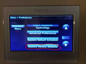 Reset Honeywell thermostat settings: Picture of the Honeywell RTH9580WF Smart Thermostat, with the Menu, Preferences, Restore Factory Defaults button circled.