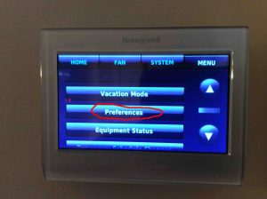 Picture of a Honeywell WiFi thermostat displaying the Menu Screen with Preferences button circled.