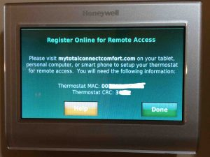 Picture of the Honeywell RTH9580WF Smart Thermostat, displaying the Register Online for Remote Access screen.