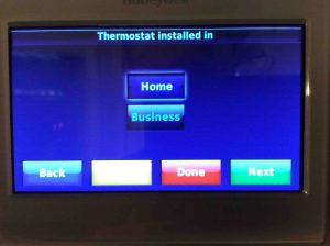 Picture of the Honeywell RTH9580WF smart WiFi thermostat, displaying the Thermostat Installed In screen. Setting temperature differential on Honeywell t-stats.