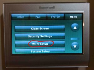 How to find Honeywell RTH9580WF thermostat IP address, MAC ID, and MAC CRC values.  Picture of the Honeywell RTH9580WF WiFi Smart Thermostat menu, with the WiFi Setup button circled.