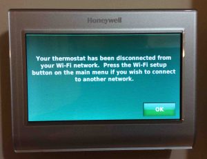 Picture of the Honeywell RTH9580WF WiFi smart t-stat , displaying the Network Disconnected screen. Reconnecting Honeywell thermostat RTH9580WF to WiFi network.