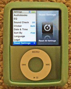 Picture of the iPod Nano 3rd Gen Portable Player. displaying the Settings menu, with the Reset Settings option selected. Restore iPod Nano 3rd generation.
