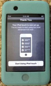 Picture of the Apple iPod Touch player, displaying the Setup Complete screen.