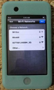 Picture of the Apple iPod Touch player, showing the WiFi Networks selection screen.