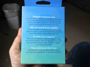 Picture of the Amazon Echo Dot 2nd Gen speaker, showing the original packaging, back view.