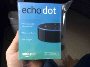 Picture of the Amazon Echo Dot 2nd Gen speaker in original package, front view.