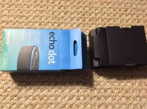 Picture of the Amazon Echo Dot 2nd Gen speaker, original package, with Inner spacer protector container pulled out.