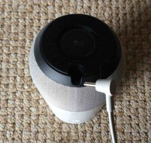 Picture of the Google Home speaker, bottom view, showing the 16.5 Volt DC barrel style power connection.