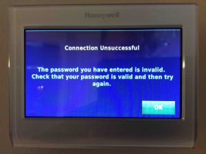 Picture of the Honeywell RTH9580WF smart thermostat, displaying the -Connection Unsuccessful- screen, due to an incorrect network password.