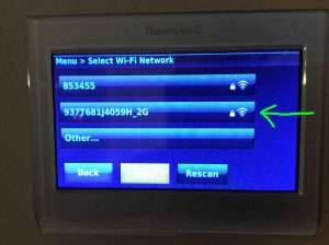Picture of the RTH9580WF, displaying the -Select Wi-Fi Network- screen, showing the wireless signal strength meter with a full strength signal.
