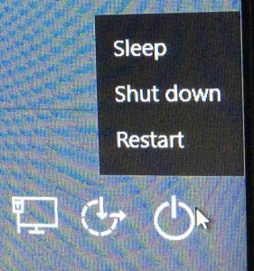 Picture of the Windows 10 logon screen, showing the Power button menu.