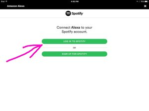 Picture of the Amazon Alexa app on iOS, displaying the -Connect Alexa to Spotify Account- screen, with the -Log In To Spotify- button highlighted