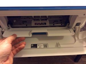 Picture of the HP Desk Jet 3632 printer, front view, showing inner access door being opened.