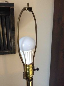 Picture of an LED light bulb in typical household lamp fixture, unlit.