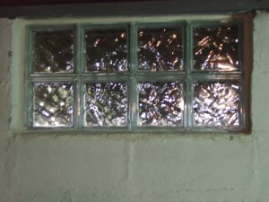 Picture of the Basement glass block window replacement 3, mortar applied Installation complete.