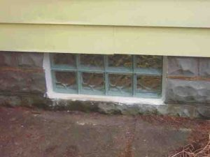 How to install glass block windows. Picture of the basement glass block window replacement 8, shims removed, installation complete, exterior view.