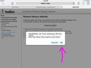 Screenshot of the WiFi repeater -Restore Factory Defaults Warning- screen, with the OK button highlighted. Reset Belkin N600 F9K1122.