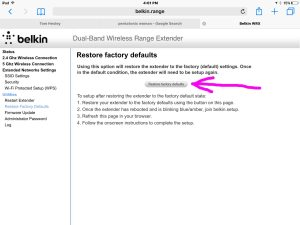 Screenshot of the range booster, displaying the -Restore Factory Defaults- page, with the -Restore Factory Defaults- button highlighted.