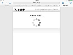 Picture of the Belkin F9K1122v1 Wi-Fi range extender, displaying the -Scanning for Wireless Networks to Extend- screen.