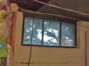 Picture of the 2nd old basement window to be replaced.