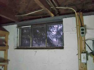 How to install glass block windows. Picture of the old, literally crumbling basement window 7, prior to replacement.