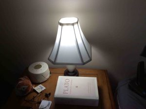 Picture of the light bulb in bedroom lamp, operating.