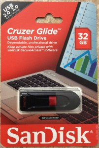 Picture of the Cruzer Glide™ 32 GB Sandisk USB flash drive, original package, front view.