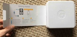 Unboxing and connecting Google Chromecast Audio receiver. Picture of the Google Chromecast Audio receiver package, flap open, showing the -Getting Started- instructions.
