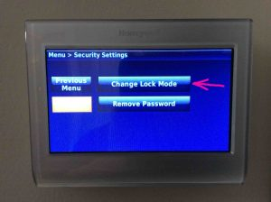 Picture of the Honeywell RTH9580WF smart thermostat, displaying its -Security Settings- screen, showing the -Remove Password- button with the -Change Lock Mode- button highlighted.