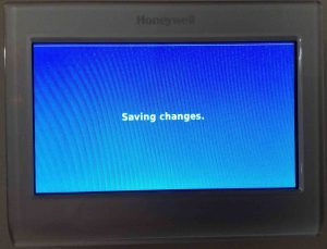 How to calibrate Honeywell thermostat temperature RTH9580WF. Picture of the Honeywell RTH9580WF thermostat, showing its -Saving Changes- screen.