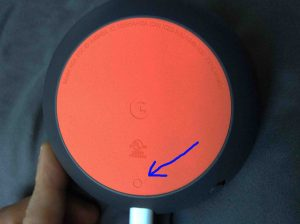 Picture of the Google Home Mini speaker, bottom view, showing the reset button highlighted.