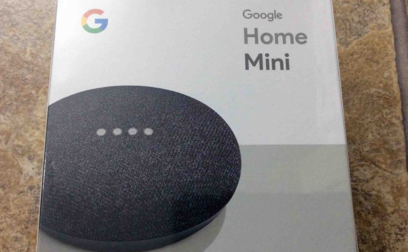 Picture of the original packaging for a brand new Google Home Mini smart speaker, front view.